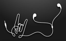 Earphones, Earbud type white color and Rock hand sign language m. Ade from cable isolated on black gradient background, with copy space Royalty Free Stock Images