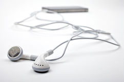 Earphones / Headphones and Music Player royalty free stock image