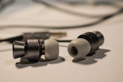 Earphones and headphones technology. Earphones and headphones stock photo