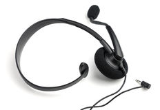 Earphones with microphone. Portable audio earphones with microphone isolated on a white background Stock Photo