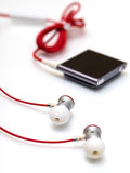 Earphones and mp3 player Royalty Free Stock Image