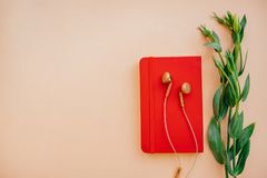 Earphones with notebook stock photography