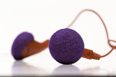 Earphones. A earphones pair, with purple and red colors Stock Photo