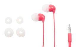 Earphones for phone of red color, on the Royalty Free Stock Photography