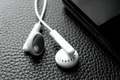 Earphones and portable music,video player Royalty Free Stock Images