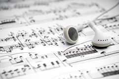 Earphones on sheet music Stock Image