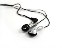 Earphones on white Royalty Free Stock Image
