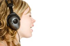 Earphones Woman. Beautiful woman listening to earphones stock photos