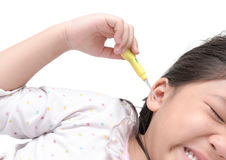 Earpick in girl hand isolated on white background Royalty Free Stock Image