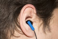 Earpiece in the human ear. Headset for communication in the human ear stock photos