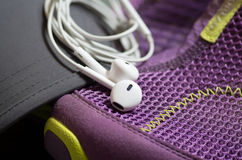 Earpieces on the trainers sport life concept Stock Image