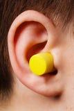 Earplug giallo Immagini Stock Libere da Diritti