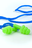 Earplugs. Lime green safety earplugs with a blue cord Stock Images