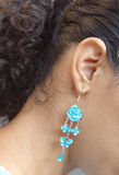 Earring. Turquise earring royalty free stock image
