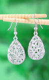 Earring. A pair of filigree earring-still life photography Stock Photography