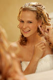 Earring. A bride on her wedding day Royalty Free Stock Images