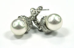Earring. Pretty earring,  earbob with pearl decoration Stock Image
