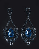 Earring with colorful blue gems on black Stock Photography