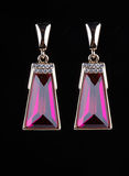 Earring with colorful pink gems on black Stock Photography