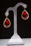 Earring with colorful red gems Royalty Free Stock Photography