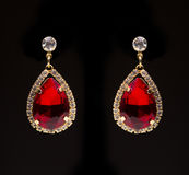 Earring with colorful red gems Stock Photography