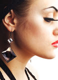 Earring and False Eyelashes Royalty Free Stock Image