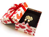 Earring in gift box Royalty Free Stock Images