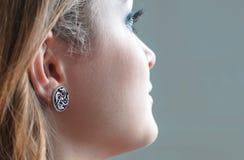 Earring on model`s ear. Royalty Free Stock Photos