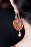 Earring with pearl royalty free stock image