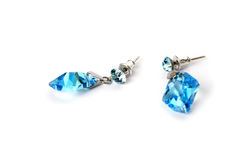Earrings. With blue stones  on white background Stock Photography