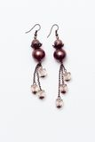 Earrings. A pair of hand made colored earings Royalty Free Stock Photo
