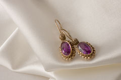 Earrings with alexandrite Royalty Free Stock Photos