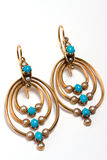 Earrings, antic jewelry. Antic gold earrings with turquoise, pearls and tiny diamonds on white background Stock Photography