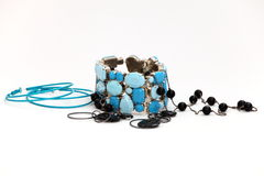 Earrings, beads and a bracelet Royalty Free Stock Images