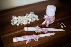 Earrings, beautiful candles and garter Royalty Free Stock Photography