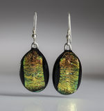 Earrings. Bespoke, craft earrings made from polished stone with silver fitting Royalty Free Stock Image