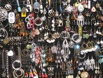Earrings on black Stock Photo