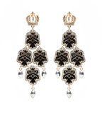 Earrings with black stones on the white Stock Images