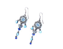 Earrings with blue stones Royalty Free Stock Photo