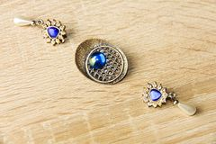Earrings and brooch Royalty Free Stock Images