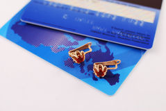 Earrings and cards Royalty Free Stock Image