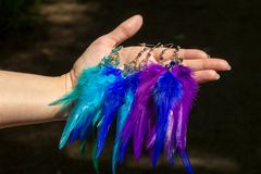 earrings of handmade dream catcher with feathers threads and beads rope hanging Stock Images