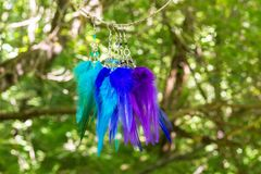 earrings of handmade dream catcher with feathers threads and beads rope hanging Stock Photography