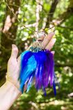 earrings of handmade dream catcher with feathers threads and beads rope hanging Royalty Free Stock Photos
