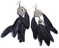 Earrings with feathers Royalty Free Stock Photo