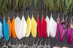 Earrings with feathers Royalty Free Stock Images