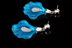 Earrings in form of lily Stock Photo