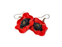 Earrings in the form of red poppies Royalty Free Stock Photography