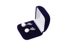 Earrings in a gift box Royalty Free Stock Photography