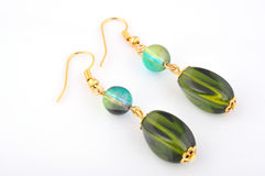 Earrings with green jewelry Royalty Free Stock Photos
